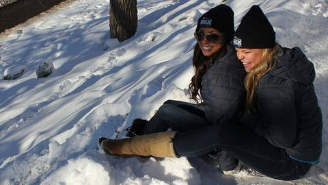 Kaylin and Kendall enjoy the fresh snow that arrived just in time for Hockey Day