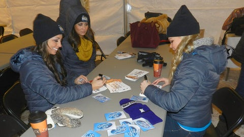 Kaylin, Angie and Kendall sign photo cards before fans start to arrive.