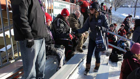 Angie hands out FOX Sports North Girls goodies to fans