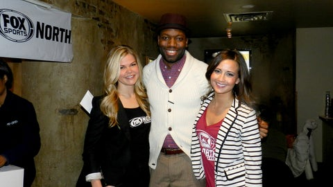Kendall and Angie posed with a lucky fan who won tickets to an upcoming game.
