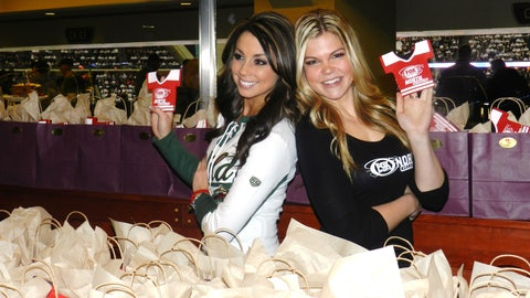 Kaylin & Kendall get ready to hand out gift bags filled with goodies - Aveda products, a special edition Minnesota Wild winter scarf, and FOX Sports North Girls bottle coolies