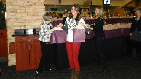 Kaylin hands out gift bags to Ladies Night attendees
