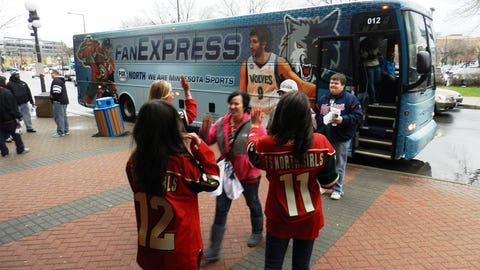 The FOX Sports North Girls greet season ticket holders outside Gate 4. The lucky fans skipped sitting in traffic and rode the FOX Sports North Fan Express bus to the game instead.