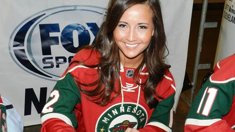The rainy weather outside won't get Angie down. It's all smiles inside the Xcel Energy Center for the Wild playoff pregame party.