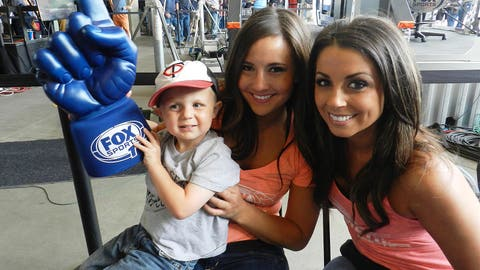 The FOX Sports 1 foam finger is almost as big as this pint-sized Twins fan.