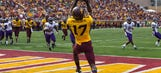 Gophers receiver catches two footballs while doing backflip