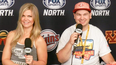 Kendall and a fan try their hand at the Be A Sports Anchor interactive inside the FOX Sports North booth.