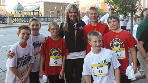 Kendall and a group of young Wild fans get ready for the Breakaway 10K/5K/1-Mile Run at the Xcel Energy Center.