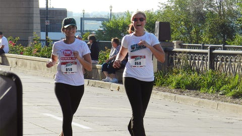 The FOX Sports North Girls prepare to cross the finish line with smiles on their faces!