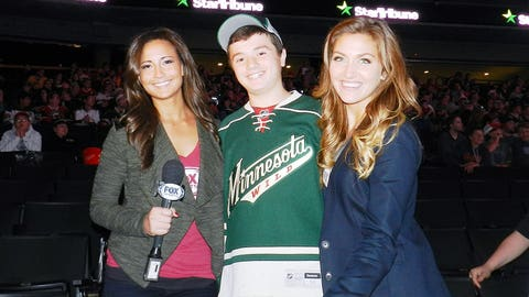Angie and Jennifer prepare to interview a fan during the 2nd Intermission of the Wild & Avs game.