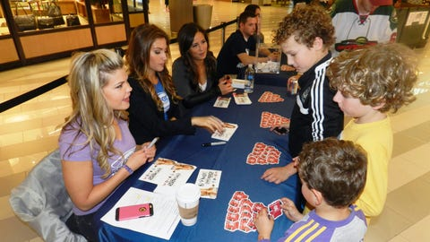 Kendall, Jennifer and Angie signed photo cards and handed out magnets to the Wild fans that stopped by.