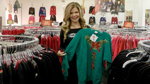 Kendall checks out some of the ugly Christmas Sweater options - this one is even Minnesota Wild green.