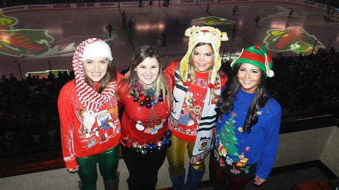 After the judging was done, the winner of the FOX Sports North Girls Ugly Christmas Sweater Contest was able to enjoy the game with Angie, Jennifer and Kendall.