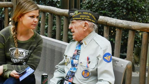 Kendall visits with a veteran at the Holiday for Heroes event.