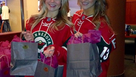 Kendall and Jennifer hand out gift bags, complete with Minnesota Wild mittens to keep your hands warm at the rink.