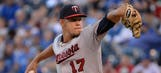Twins use 9 pitchers in extra-innings loss to Royals
