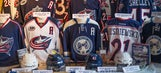 Blue Jackets fans show support; tell team history on their backs