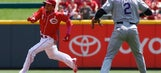 Reds clinch series with 4-1 win over Rockies