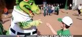 Mascot, boy communicate via sign language
