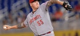 Reds' Latos gets 1st win against hometown Marlins