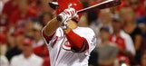 Reds try to keep bats going against Miami