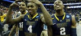West Virginia pounds boards to beat Maryland
