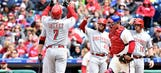 Reds explode for 9 runs in win over Phillies