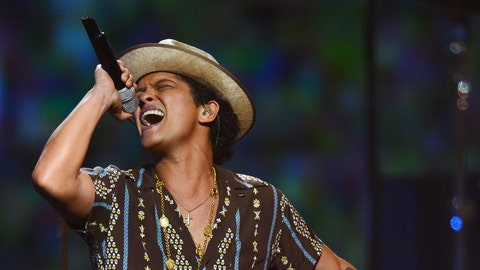 Which song will Bruno Mars perform first?