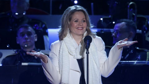 If Renee Fleming wears gloves when she starts singing US National Anthem what color will they be?