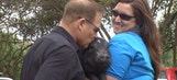 Les Miles kisses a pig for charity
