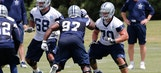 Cowboys offensive, defensive linemen all wearing knee braces during minicamp