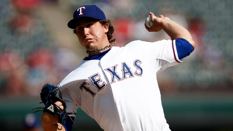 On the second day of Christmas the Rangers need: Derek Holland's results to back up what he's talking about.