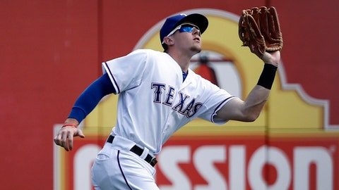 On the third day of Christmas the Rangers need: Someone to step in left field.