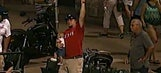 Man makes one-handed catch with baby in other hand at minor-league game