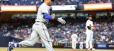 Rangers rally to beat Yankees after long rain delay