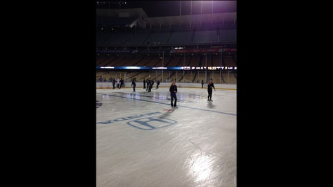 A general view of media members skating on the ice prior to the 2014 Coors Light NHL Stadium Series game on January 25, 2014 at Dodger Stadium.