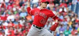 Richards sharp on mound as Angels blank Phillies