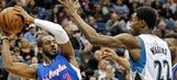 Paul plays through knee pain, helps Clippers outlast Wolves