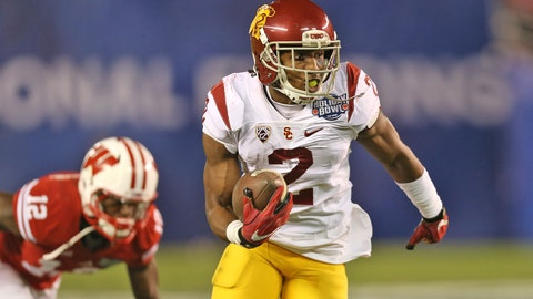 Badgers Edge Trojans in Holiday Bowl