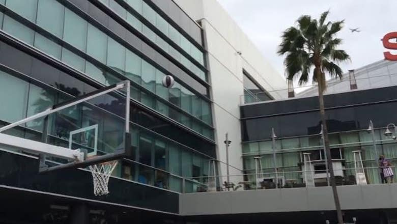 'Get in the hole!' Harlem Globetrotter hits long shot from Staples Center balcony