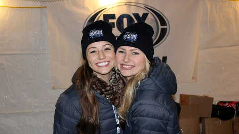 Sage and Chyna take a break to warm up in a heated tent at Hockey Day Minnesota.