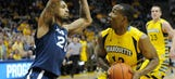 Marquette holds off Xavier, wins third straight