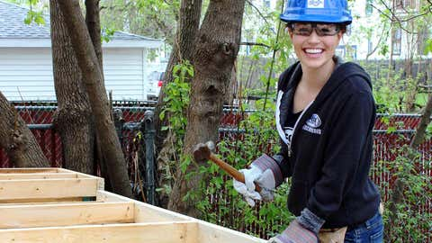 Sage is all smiles while building walls.