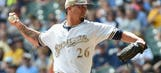 Bad breaks spell doom for Brewers in extra-innings setback