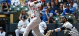 Reds' offense overwhelms Brewers, 13-4