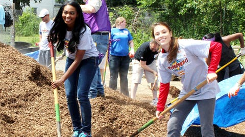 All smiles while shoveling mulch for the playground.