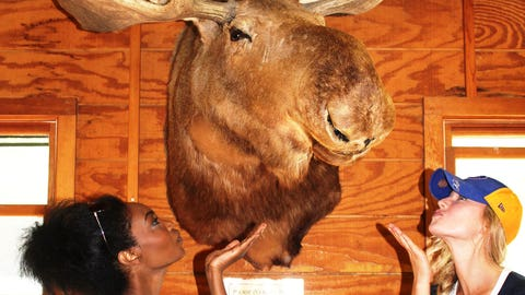 Bishara and Chyna participate in a camp tradition of kissing the moose.