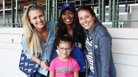The FOX Sports Wisconsin Girls strike a pose with a pint-sized model.