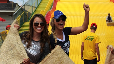 The FOX Sports Wisconsin Girls channeled the racing sausages as they took on the State Fair's Giant Slide.