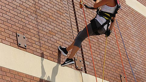Sage shows off her rappelling skills.